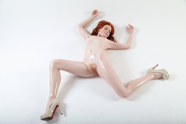 oily redhead posing on the ground; Red Head Stylish Unshaven Pussy
